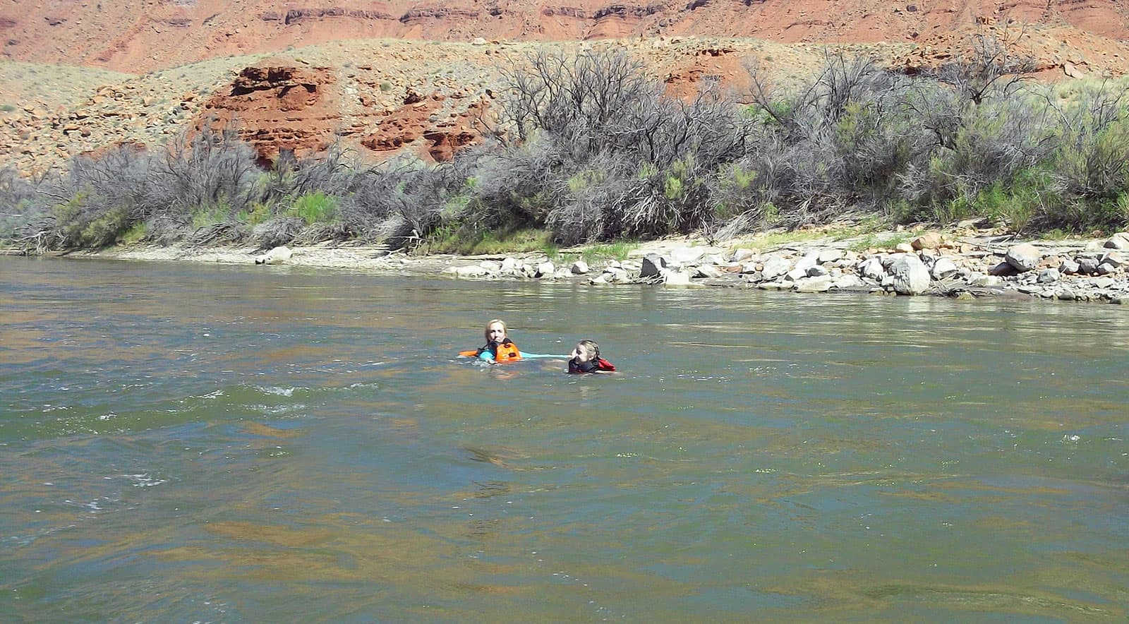 Teyla floating in the Colorado River