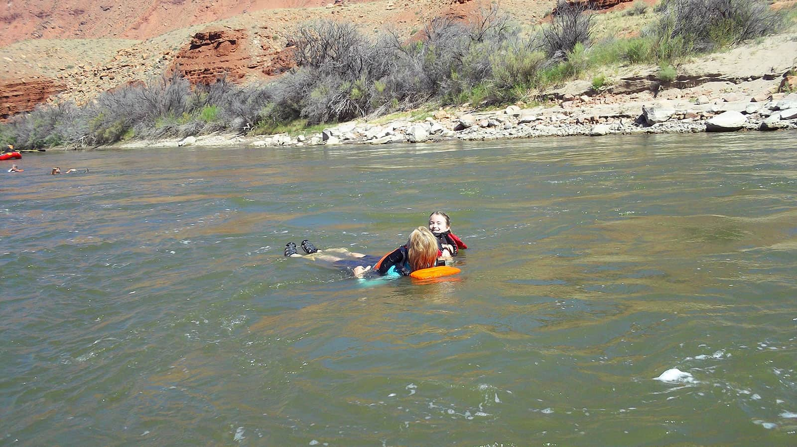 Teyla and Lisbon floating in the Colorado River